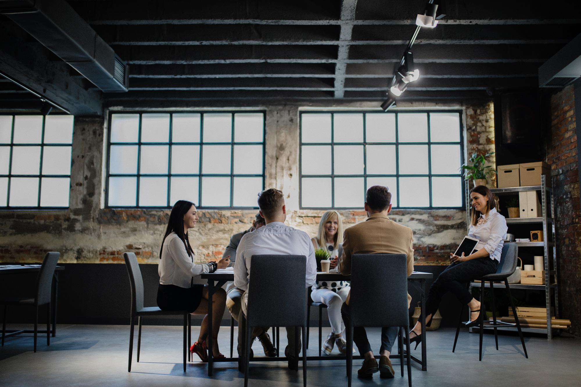 Team sitting around desk